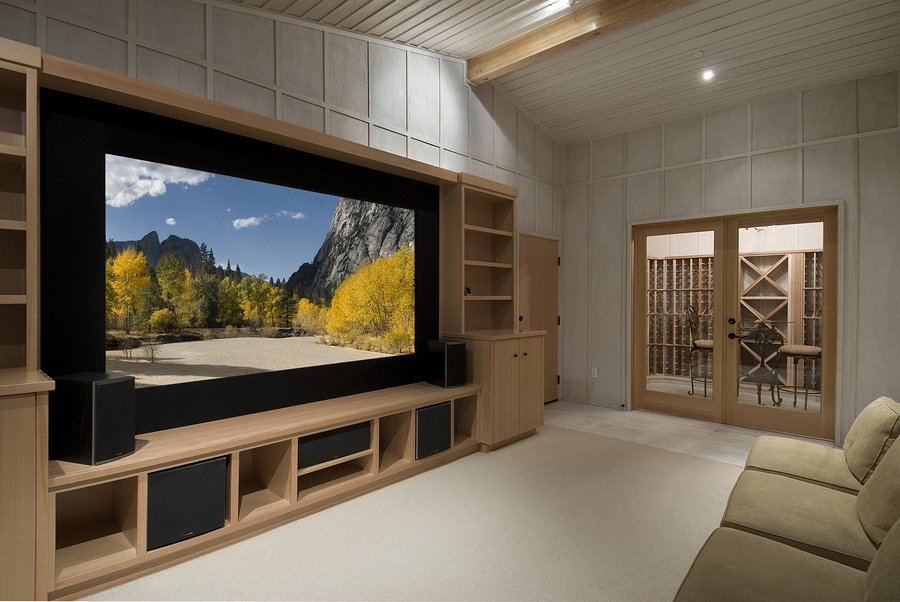 home theater with wine tasting room big screen wood cabinetsphoto on screen is one of my shots from yosemite