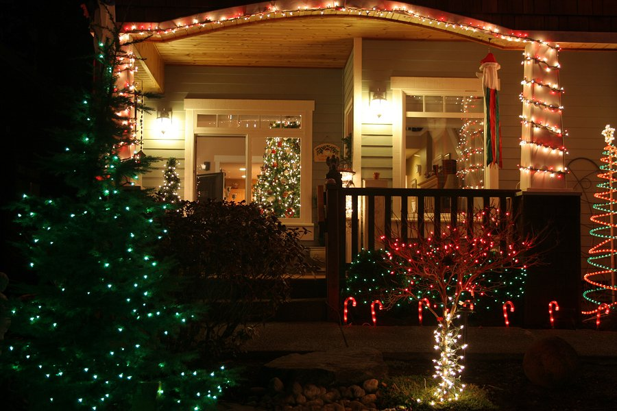 the front entry of a house lit up by Chrismas lights at night