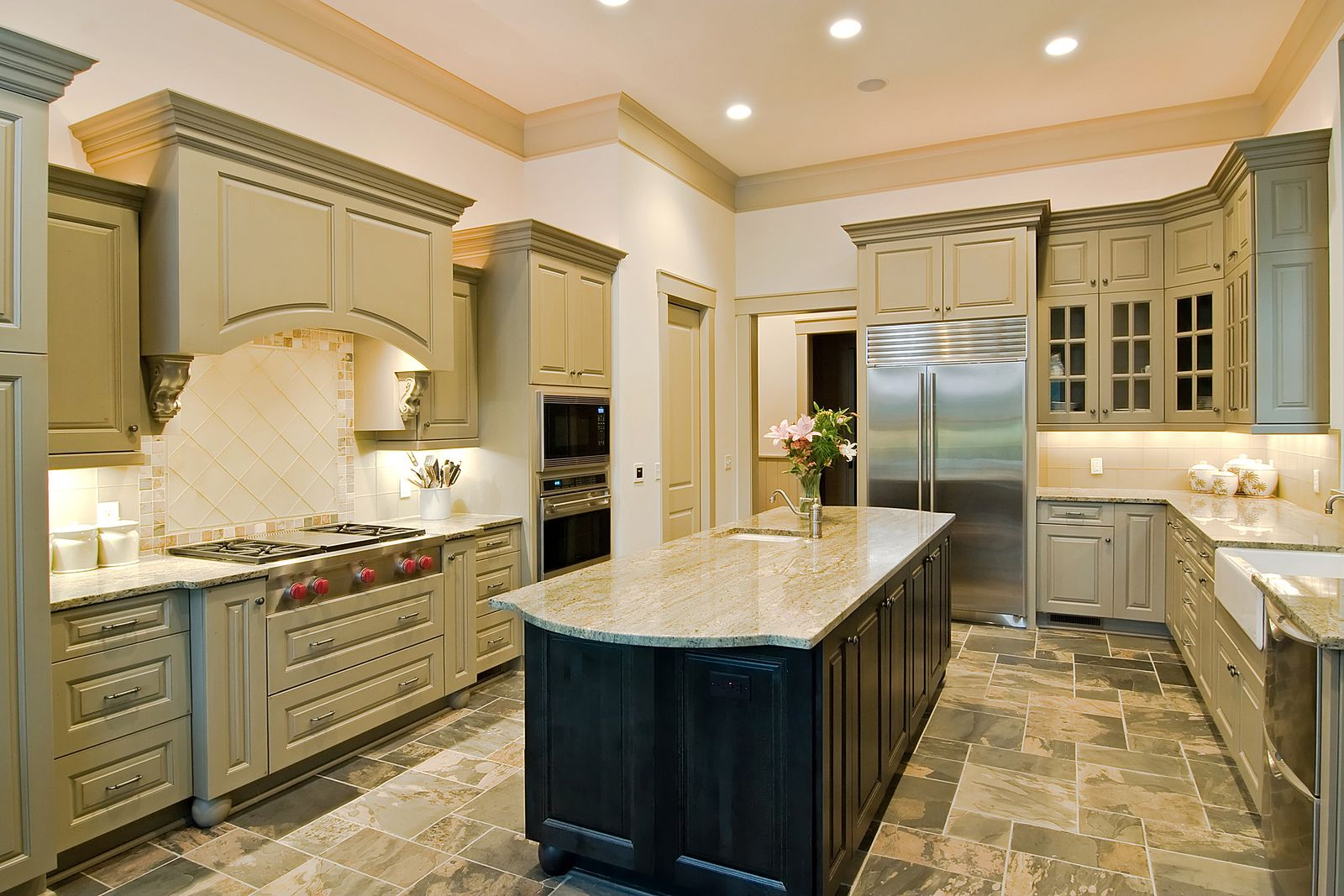 A kitchen with cabinets and lights